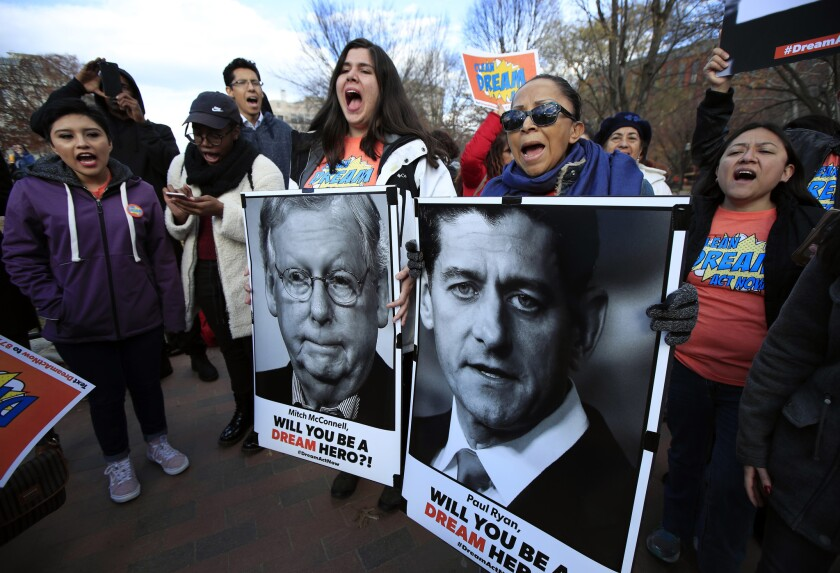 Amanda Bayer, left with banner, and Marisol Maqueda, right with banner, join a rally in support of so-called Dreamers outside the White House.