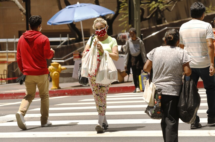 Demetria Christ carries her groceries after shopping at FIGat7th