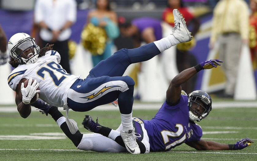 San Diego Chargers running back Melvin Gordon (28) is upended by Baltimore Ravens cornerback Lardarius Webb (21) during the second half of an NFL football game in Baltimore, Sunday, Nov. 1, 2015. (AP Photo/Nick Wass)