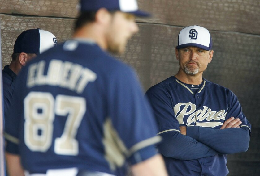 Former Padres pitcher Trevor Hoffman watches Scott Elbert throw pitches in bullpen on the second day of spring training at the Peoria Sports Complex in Peoria, Arizona on Saturday.