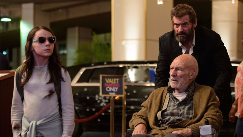 "Dafne Keen as Laura, Hugh Jackman as Logan/Wolverine and Patrick Stewart as Charles in the film ""Logan."""