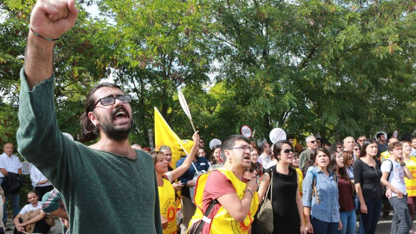Demonstrators shout during a protest against the suspension of academics from universities following a post-coup emergency decree in Ankara