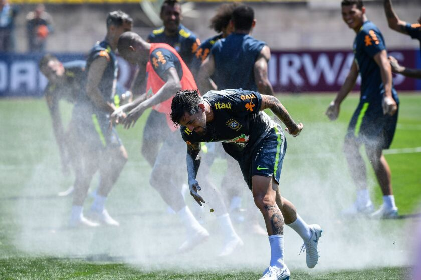 Brazil's national team players break an egg on the head of Fagner (C), who celebrated his birthday the day before, during a training session at Sochi Municipal Stadium in Sochi on June 12, 2018, ahead of the Russia 2018 World Cup football tournament.