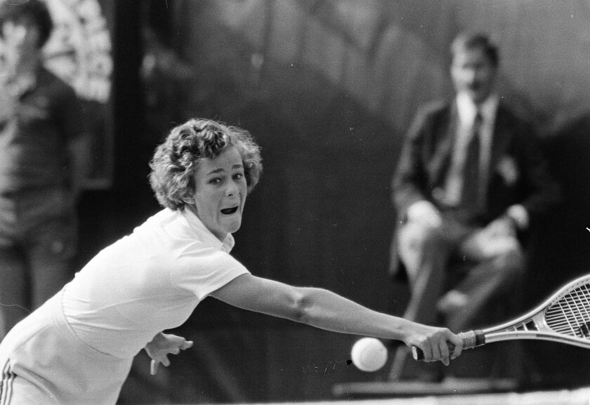 Pam Shriver, 16, grimaces as she pursues a shot by Chris Evert during the women's singles final at the 1978 U.S. Open.