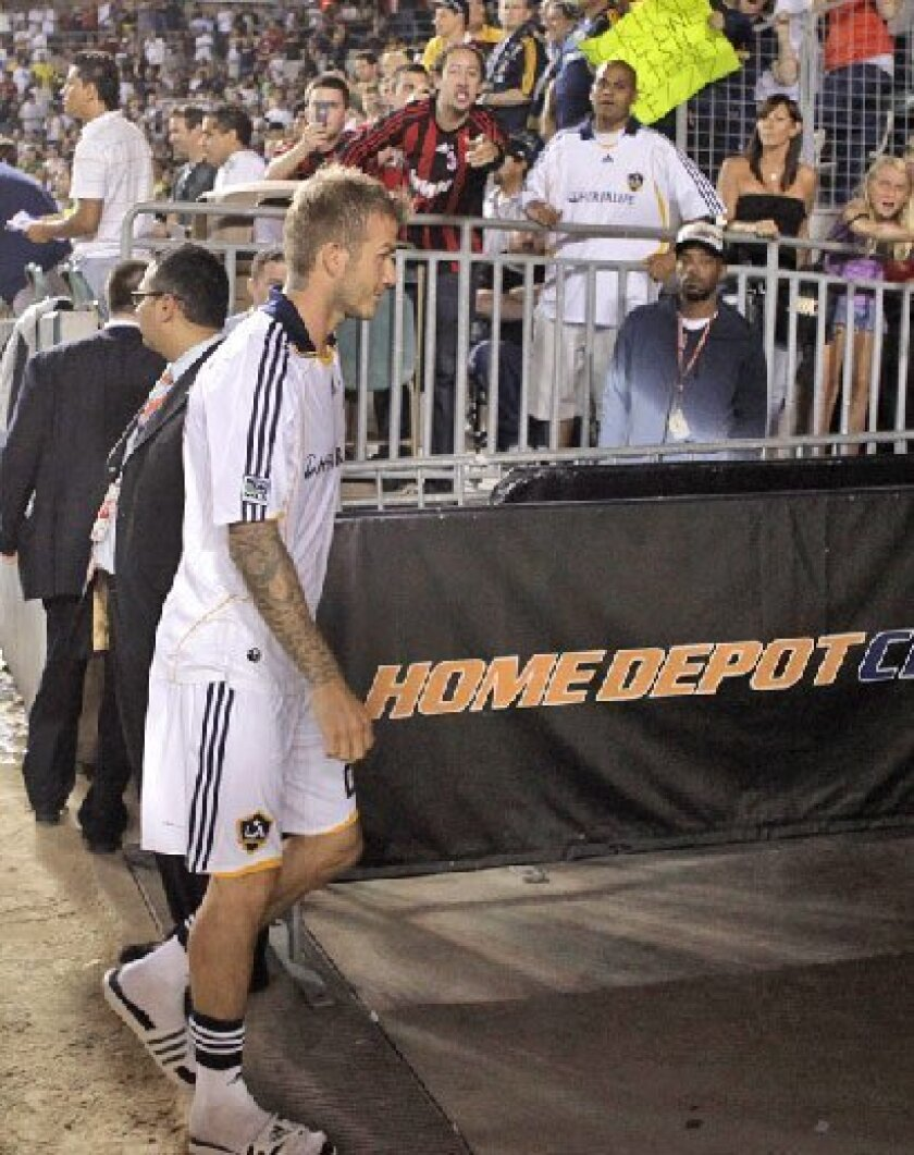 David Beckham got an ugly reception in his first  home game back with the Galaxy. (Associated Press)