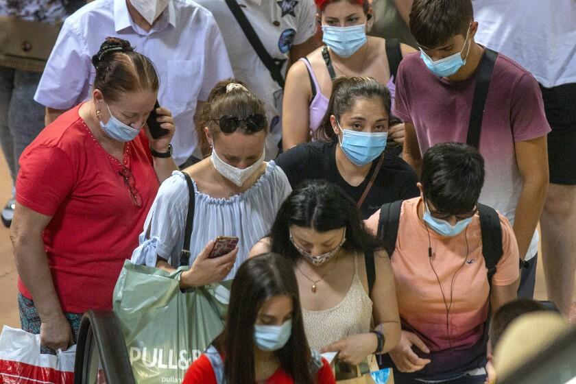 Passengers prepare to board a train in Madrid.