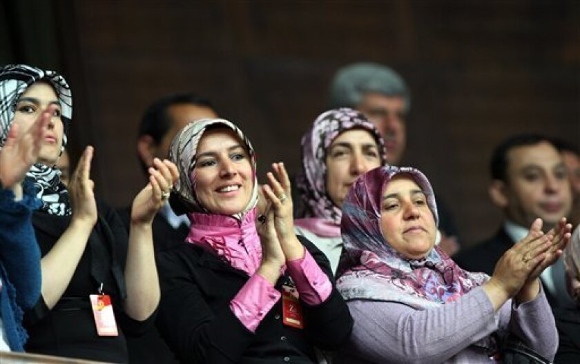 Supporters applaud as Turkish Prime Minister Recep Tayyip Erdogan, unseen,  addresses his lawmakers at the parliament in Ankara, Turkey, Tuesday, June 1, 2010, a day after Israeli naval commandos stormed a flotilla of ships carrying aid and hundreds of pro-Palestinian activists to the blockaded Gaz