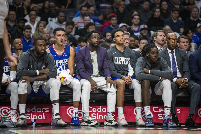 Players on the Clippers' bench react during the final minutes of the team's 140-114 loss to the Grizzlies on Saturday afternoon.