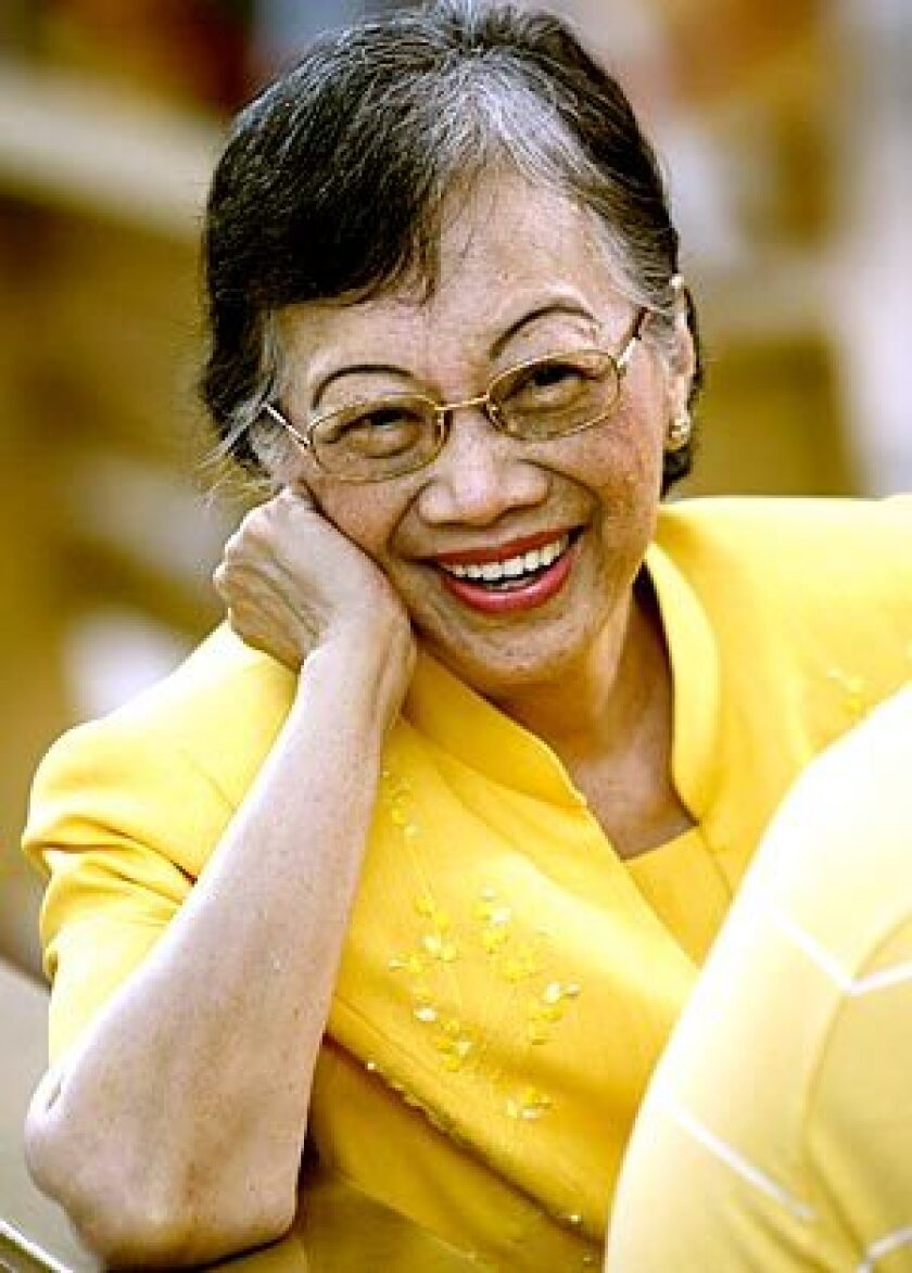 Aquino, in her signature yellow, attends Mass in 2008 to commemorate the 25th anniversary of her husband's slaying, which sparked a nonviolent uprising that toppled dictator Ferdinand Marcos and brought her to power.