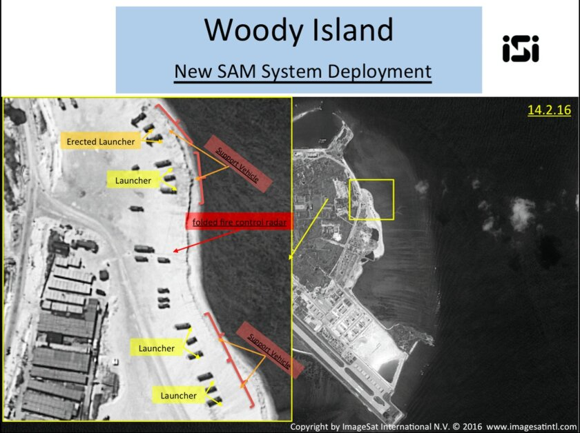 This image with notations provided by ImageSat International N.V., Wednesday, Feb. 17, 2016, shows satellite images of Woody Island, the largest of the Paracel Islands in the South China Sea. A U.S. official confirmed that China has placed a surface-to-air missile system on Woody Island in the Para