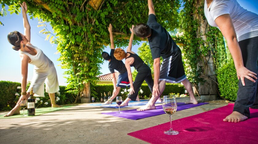 At South Coast Resort & Spa, wine is served for outdoor yoga sessions.