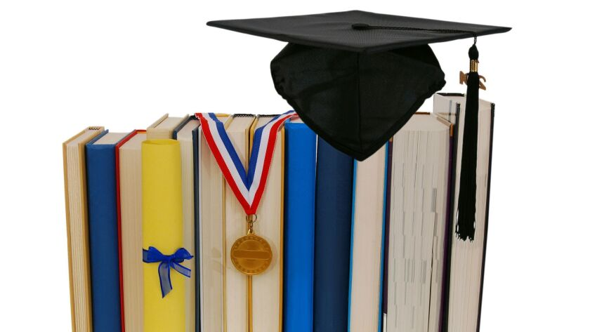 Cap graduation with medal, diploma and books
