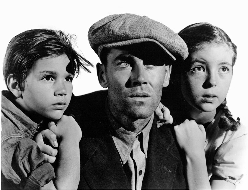 "Henry Fonda, center, as Tom Joad in the 1940 movie ""The Grapes of Wrath."""