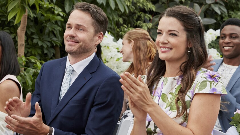 "Paul Campbell and Kimberley Sustad in the TV romance""Wedding Every Weekend"" on Hallmark."