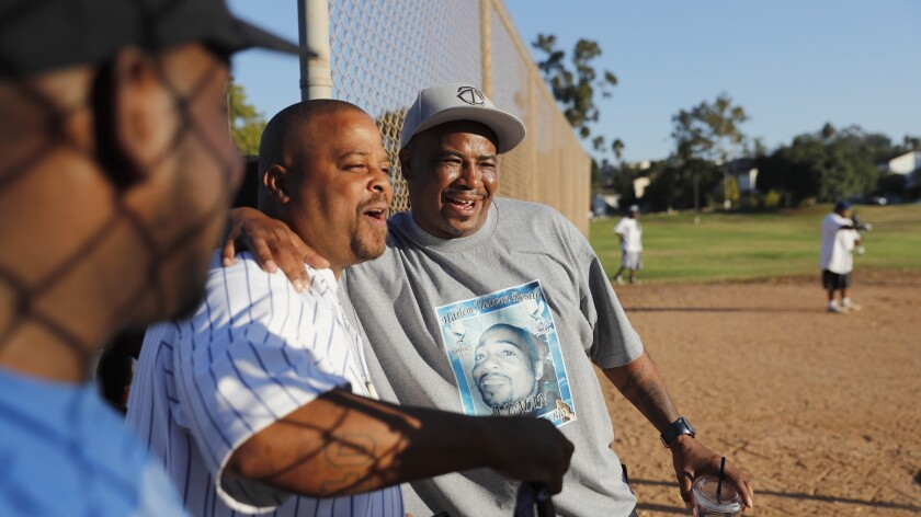 """Garry """"Twin"""" Dorton, center, at the Crips softball championship game in October 2017."""