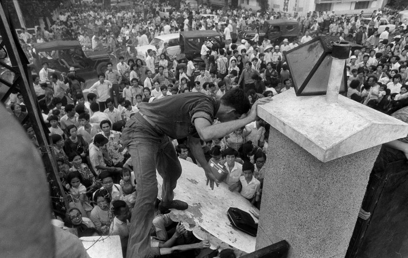 As Americans depart Vietnam on April 29, 1975, South Vietnamese residents try to scale the 14-foot wall of the U.S. Embassy in Saigon in an attempt to reach evacuation helicopters.
