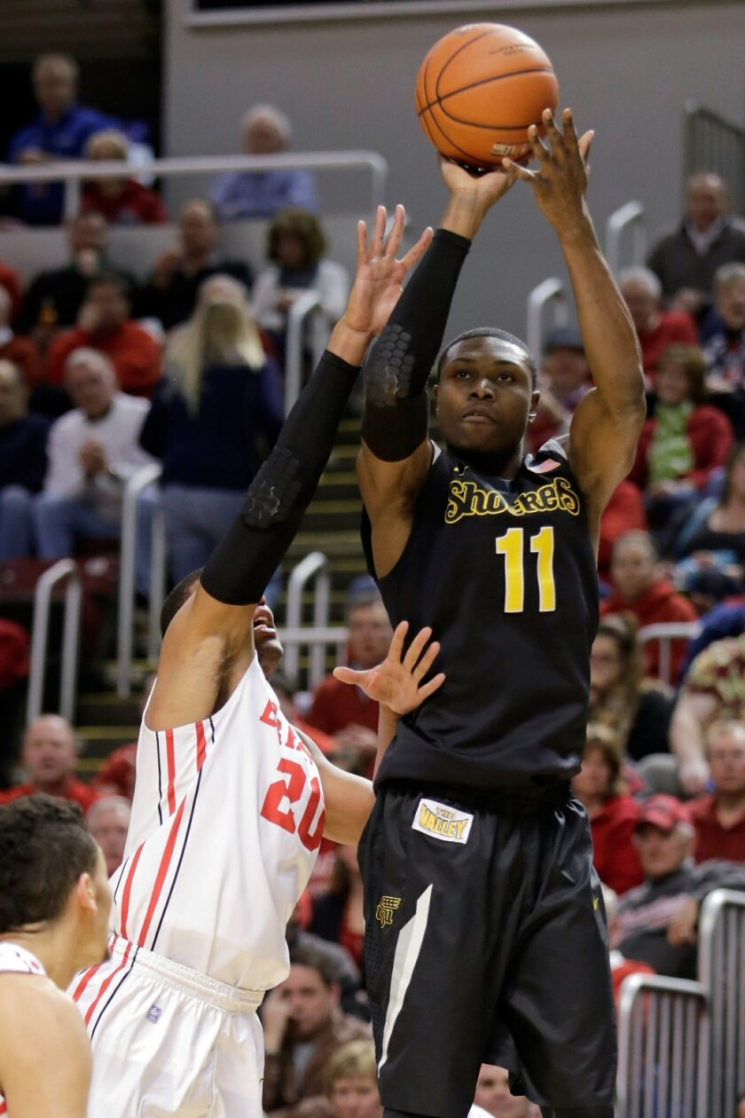 Wichita State forward Cleanthony Early (11) shoots against Bradley forward Tyshon Pickett (20) during the first half of an NCAA college basketball game at Carver Arena, Tuesday, Feb. 25, 2014, in Peoria, Ill. (AP Photo/ Stephen Haas)