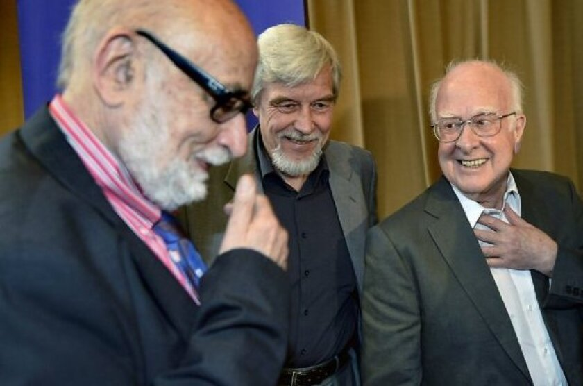 (Left to right) Francois Englert, Rolf Heuer, Director General of CERN, and Peter Higgs in Meyrin near Geneva, shortly after they discovered the Higgs Boson.