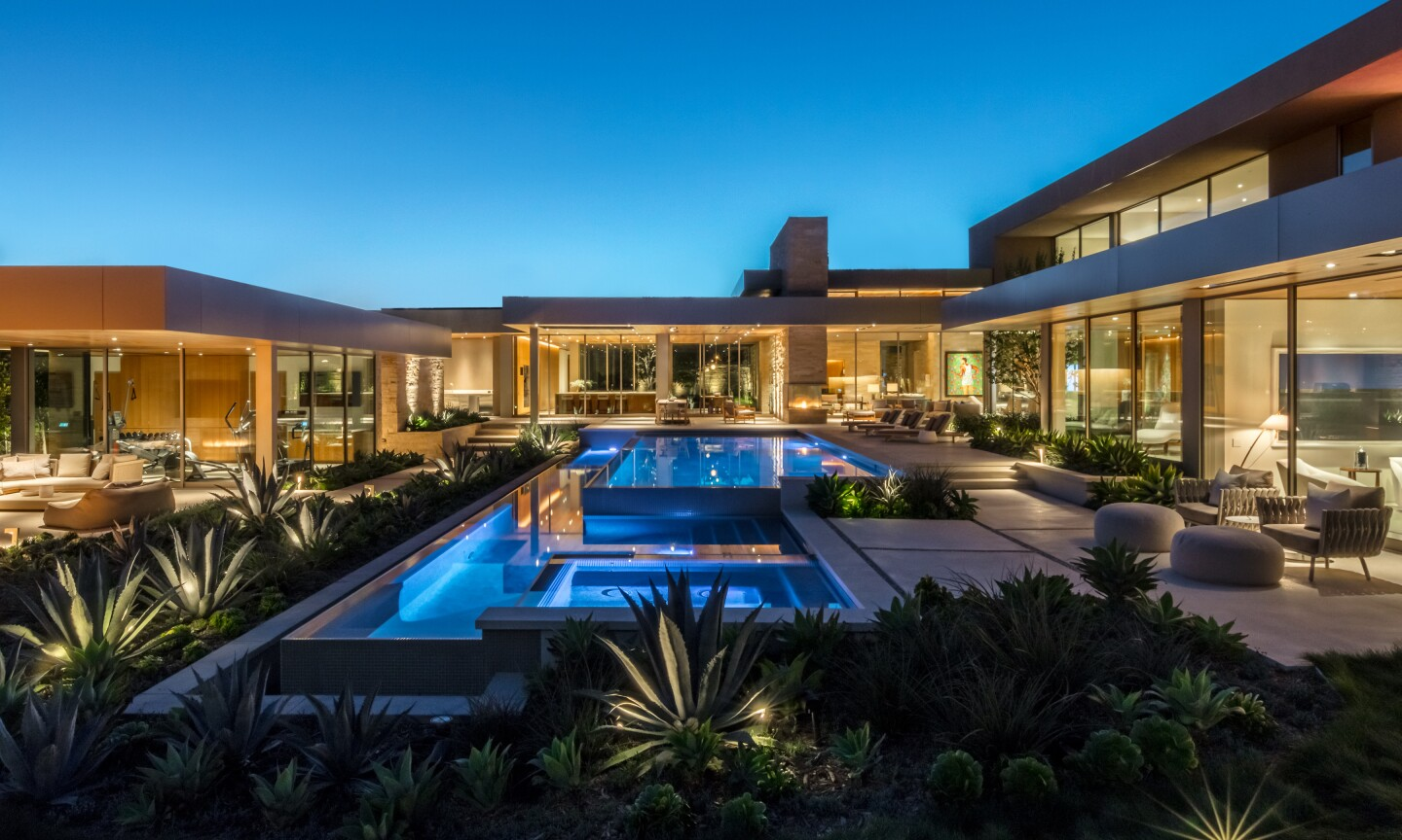 The one-acre estate includes a brand new home, a climate-controlled auto gallery and a gym and spa facility.