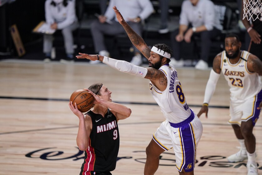 Lakers forward Markieff Morris leaps to try to block a shot by Heat center Kelly Olynyk during Game 3 on Sunday night.