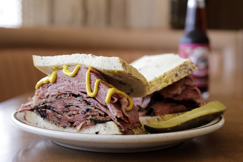 LOS ANGELES, CA -- JULY 13, 2018: Canter's Fairfax Sandwich is hot corned beef and pastrami on rye b