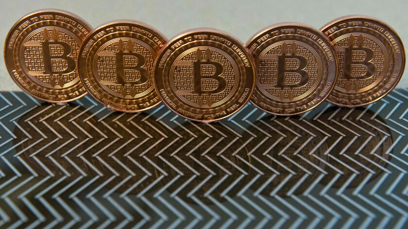 Bitcoin medals shown in a file photo taken June 17, 2014.