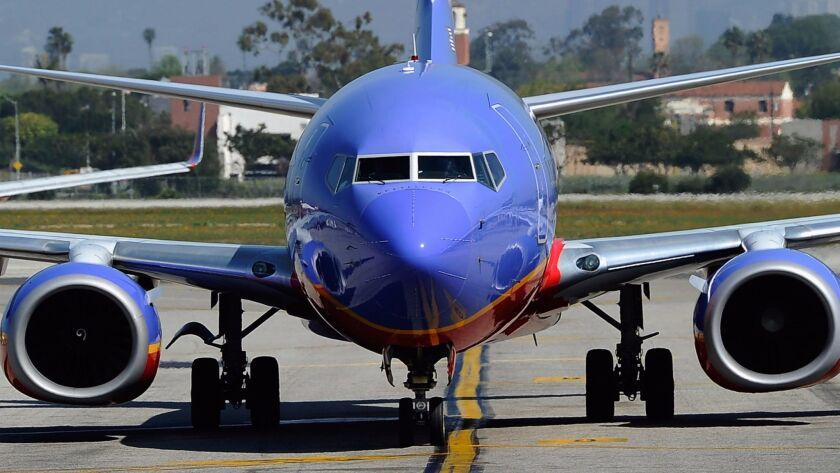 A Southwest Airlines jet taxis toward the terminal after arriving at Los Angeles International Airport in April 2011.