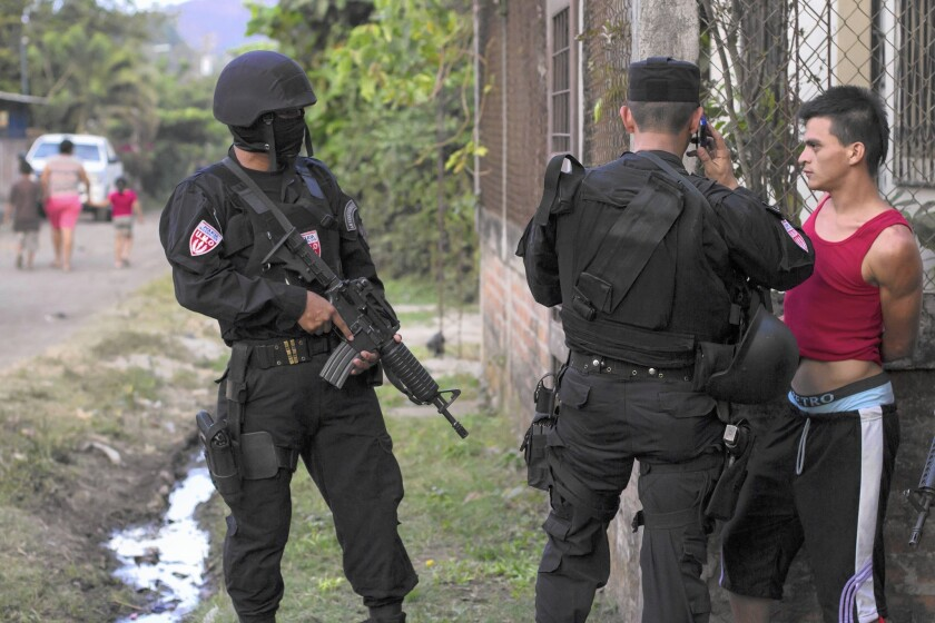 A man is detained by police special forces in San Juan Opico, El Salvador. The country has seen a fresh uptick in gang violence.