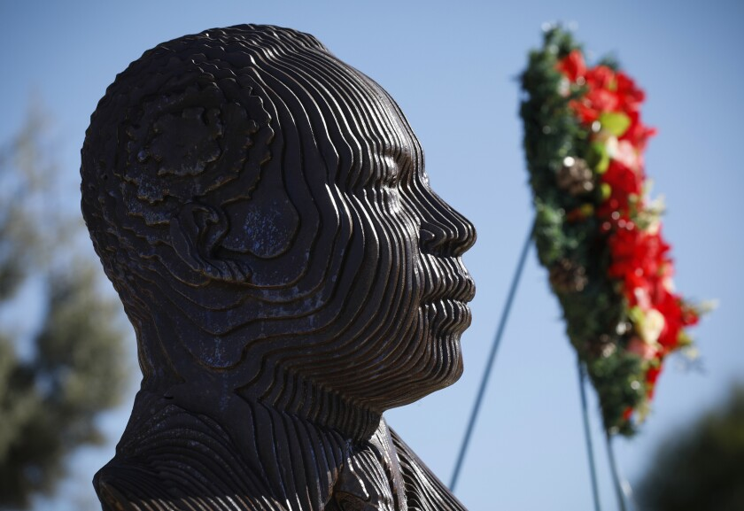 A bust of King and a commemorative wreath are part of Broadway Heights' celebration.