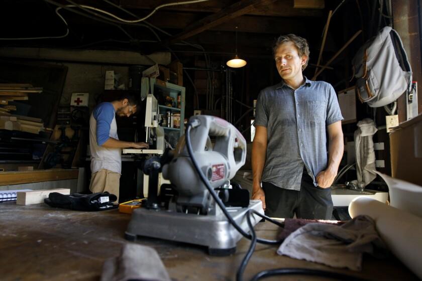 Furniture and lighting designer Brendan Ravenhill, right, runs his small industrial design studio out of his Echo Park home. At left, designer Dash Krehel.