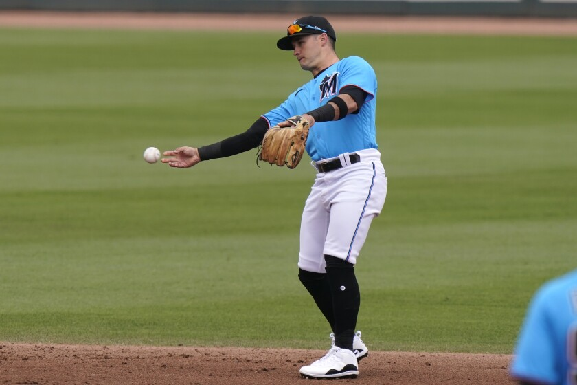 Miami Marlins shortstop Eddy Alvarez warms up during a spring training game.