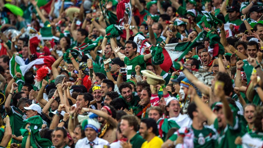 Mexico fans celebrate a goal during the team's 3-1 World Cup win over Croatia on Monday.