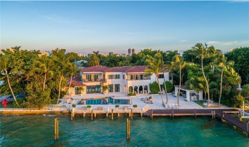 Set on Biscayne Bay, the one-acre estate holds a 14,000-square-foot mansion, a dining gazebo, a swimming pool and a Miami Heat-themed basketball court.