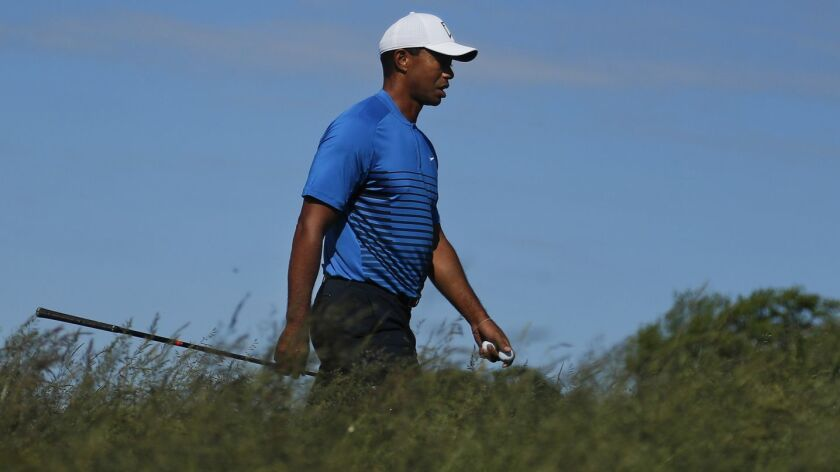 Tiger Woods walks up to the sixth tee during a practice round for the U.S. Open Golf Championship, T