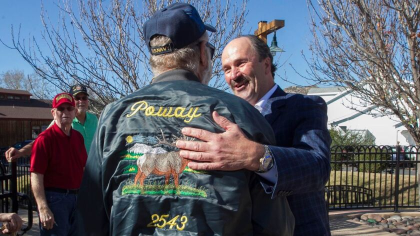 Poway City Councilman Jim Cunningham greets veteran Dennis Rasmussen at the Veterans Park in Poway Monday afternoon. He plans to retire from the council in June.