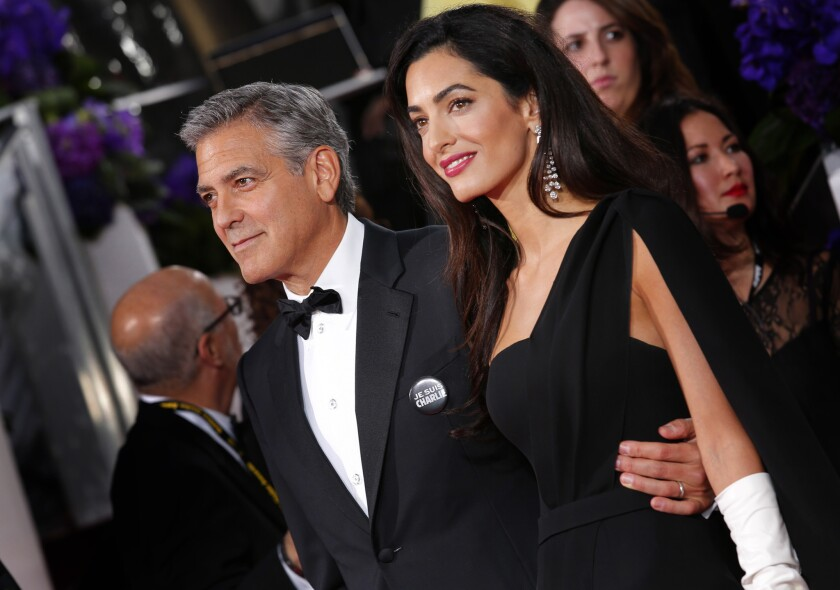 Amal Clooney appears with her husband George at the Golden Globe Awards in January. Her makeup was styled by Charlotte Tilbury.