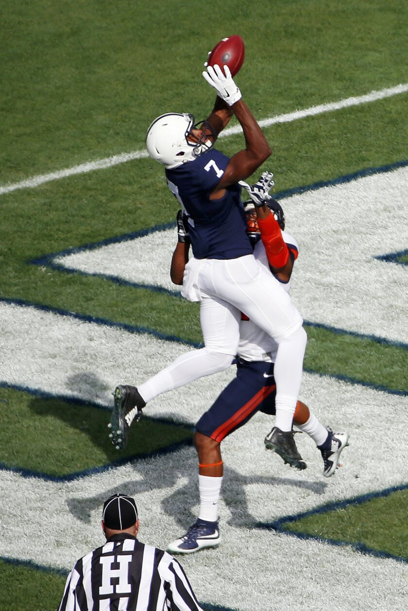 Penn State wide receiver Geno Lewis (7) catches a touchdown pass from quarterback Christian Hackenberg over Illinois defensive back Eaton Spence (27) during the first half of an NCAA college football game in State College, Pa., Saturday, Oct. 31, 2015. (AP Photo/Gene J. Puskar)
