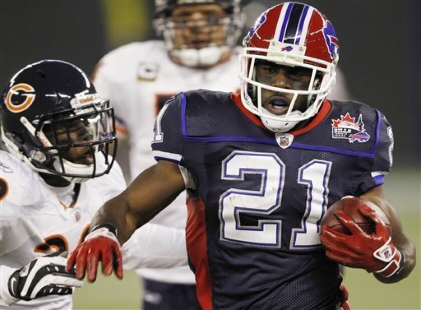 Buffalo Bills running back C.J. Spiller (21) runs past Chicago Bears' defender D.J. Moore (30) during the first half of an NFL football game at the Rogers Centre in Toronto, on Sunday, Nov. 7, 2010. (AP Photo/Mike Groll)