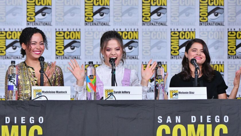 "From left to right, Madeleine Mantock, Sarah Jeffery and Melonie Diaz speak onstage during the ""Charmed"" screening and panel at Comic-Con International 2018 in San Diego, California."