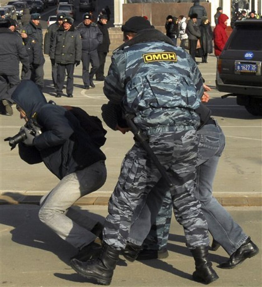 Police detains participants of a protest against the authorities' plans to raise tariffs on imported used Japanese cars in central part of the Pacific port of Vladivostok, about 6,400 km (4,000 miles) east of Moscow, Sunday, Dec. 21, 2008. Some 500 motorists rallied in Russia's far east Saturday to