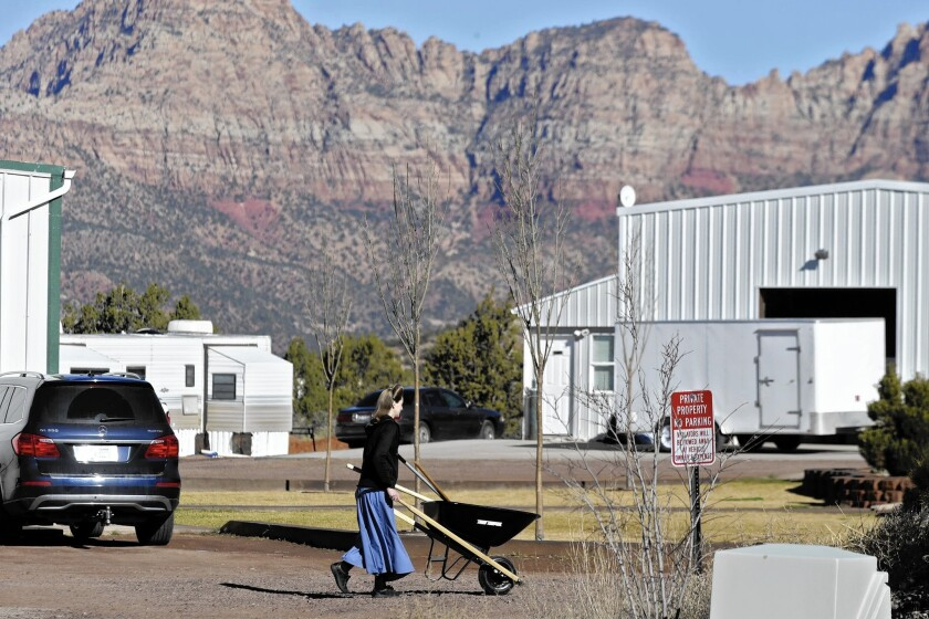Hildale, Utah, pictured, and Colorado City, Ariz., are border towns long overseen by a polygamist sect. A jury decision may change that.