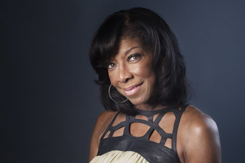 """FILE- In a Wednesday, June 26, 2013 file photo, Grammy winning singer-songwriter Natalie Cole poses for a portrait in promotion of her new album """"Natalie Cole en Espanol,"""" in New York. Veteran Grammys executive producer says his awards show does not have a diversity issue like the Oscars and that i"""