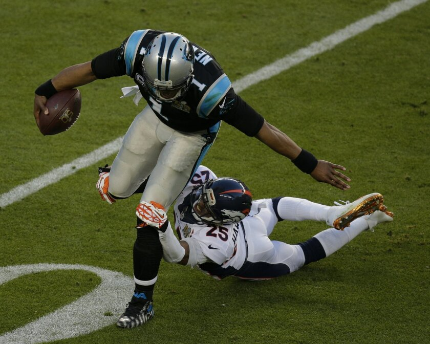 Carolina Panthers' Cam Newton (1) tries to run past Denver Broncos' Chris Harris Jr. (25) during the first half of the NFL Super Bowl 50 football game Sunday, Feb. 7, 2016, in Santa Clara, Calif. (AP Photo/Charlie Riedel)