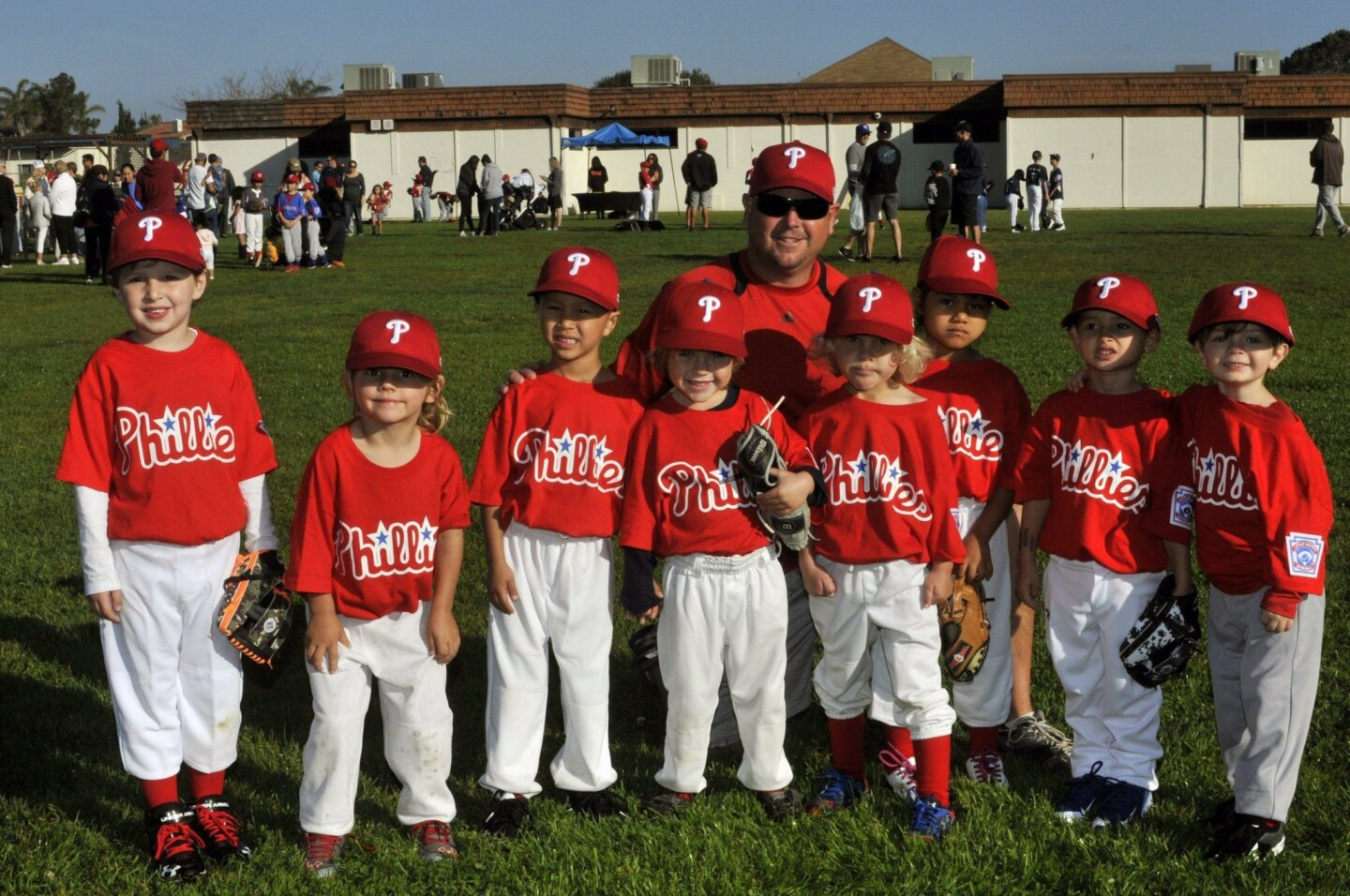 Manager Eric Wilburn with Phillies Kai, Parker, Liam, Jackson, Tosh, Lorett, Paul and Hudson