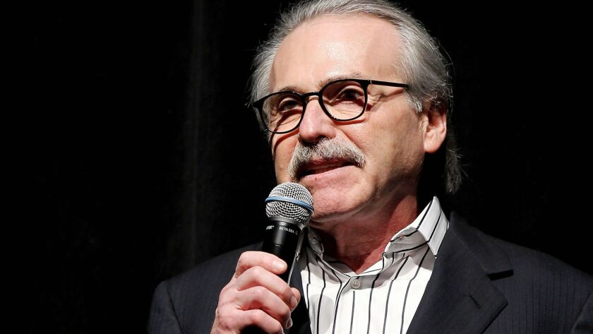 National Enquirer Chief Executive David Pecker, shown in 2014, has reportedly been granted immunity by federal prosecutors.