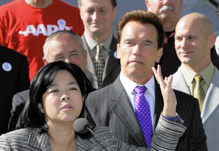 Kathay Feng of California Common Cause, at a 2008 event with then-Gov. Arnold Schwarzenegger. Feng's group backed creation of the state's citizen redistricting commission.