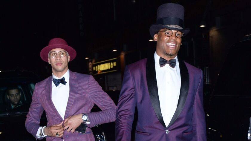 Cam Newton and Miles Chamley-Watson suit up for Rihanna's Met Gala after-party in New York.