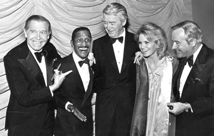 Milton Berle, left, Sammy Davis Jr., James Stewart, Angie Dickinson and Jack Lemmon at a 1980 Friars Club event.