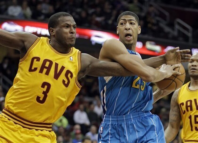 Cleveland Cavaliers' Dion Waiters (3) fouls New Orleans Hornets' Anthony Davis during the first quarter of an NBA basketball game Wednesday, Feb. 20, 2013, in Cleveland. (AP Photo/Mark Duncan)