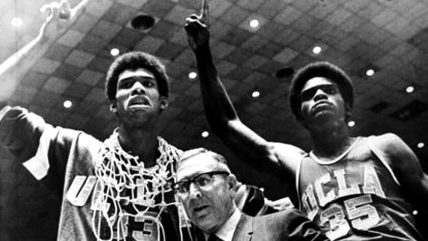 UCLA Coach John Wooden is flanked by Kareem Abdul-Jabbar (33) and Sidney Wicks (35) after the Bruins beat Purdue to win the NCAA basketball title on March 24, 1969, in Louisville, Ky.